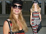 Los Angeles, CA - Paris Hilton looks absolutely stunning as she arrives at LAX dressed in a striped maxi dress and cross body bag. \nAKM-GSI      March 25, 2016\nTo License These Photos, Please Contact :\nSteve Ginsburg\n(310) 505-8447\n(323) 423-9397\nsteve@akmgsi.com\nsales@akmgsi.com\nor\nMaria Buda\n(917) 242-1505\nmbuda@akmgsi.com\nginsburgspalyinc@gmail.com