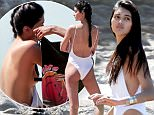 149862, EXCLUSIVE: British model Neelam Gill shows off her ample assets on a sexy beach photoshoot in Malibu. Malibu, California - Thursday, March 24, 2016. Photograph: © PacificCoastNews. Los Angeles Office: +1 310.822.0419 UK Office: +44 (0) 20 7421 6000 sales@pacificcoastnews.com FEE MUST BE AGREED PRIOR TO USAGE