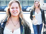 Picture Shows: Ronda Rousey  March 24, 2016\n \n MMA fighter Ronda Rousey was spotted grabbing some coffee from Starbucks in Los Angeles, California.\n \n Before getting something to drink, two police officers stopped to ask her for a photo. Ronda was dressed casually in a black leather jacket, a white button up top, blue skinny jeans and black boots.\n \n Exclusive ALL ROUND\n UK RIGHTS ONLY\n \n Pictures by : FameFlynet UK © 2016\n Tel : +44 (0)20 3551 5049\n Email : info@fameflynet.uk.com