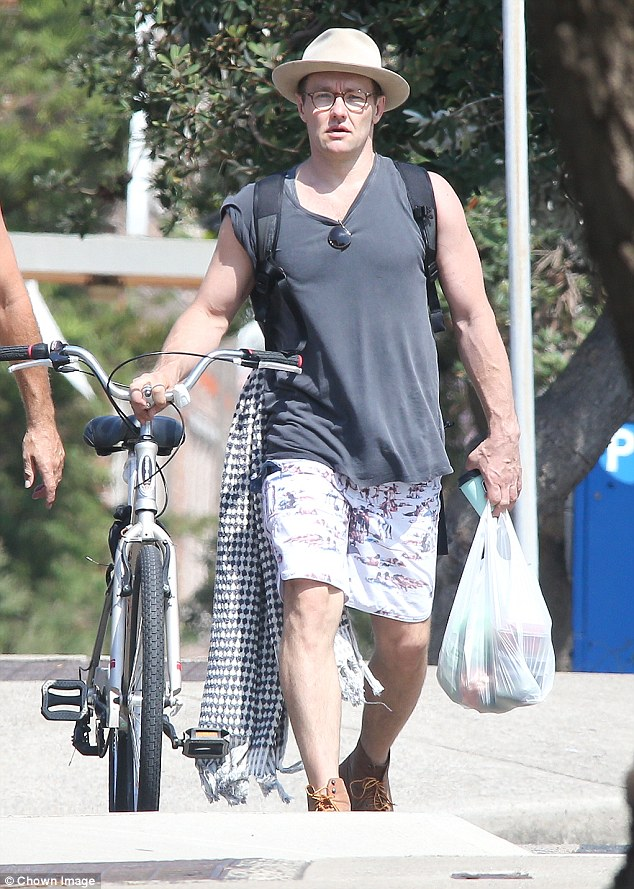 Buff: Joel Edgerton showcased his muscular arms as he stepped out for a bike ride in Sydney's Bondi on Saturday afternoon