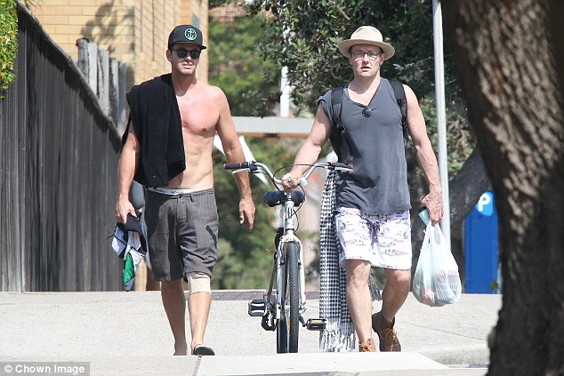 Who's that guy? Joel was joined by a handsome male friend, who opted to go shirtless for the journey