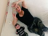 cocoChanel & I having fun with the mirror above our bed.. I need one of these at home..LOL #Twinsies