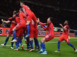 epa05232179 England's team celebrates the winning goal during the international friendly soccer match between Germany and England in Berlin, Germany, 26 March 2016.  EPA/ANNEGRET HILSE