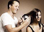 HAIRDRESSER, SHAUN PULFREY, DEMONSTRATES HIS TANGLE TEEZER ON A MODEL. SHAUN INVENTED THE HAIRBRUSH WHICH IS DESIGNED TO SMOOTH KNOTTED HAIR AND  HAS LANDED A CONTRACT WTH BOOTS AFFTER BEING REJECTED BY BUSINESS TEAM ON THE TELEVISION PROGRAMME DRAGON'S DEN........Shaun Pulfrey copyright unknown