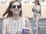 Exclusive... 52006441 'Scream Queens' actress Emma Roberts and a friend stop by Coffee Bean & Tea Leaf for an iced coffee on Easter Sunday in West Hollywood, California on March 27, 2016. Emma was wearing red heels to match her new red hair. FameFlynet, Inc - Beverly Hills, CA, USA - +1 (310) 505-9876