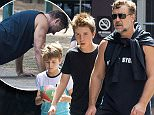 26 MARCH 2016 SYDNEY AUSTRALIA\nEXCLUSIVE PICTURES\nRussell Crowe pictured with his son's Charlie and Tennyson taking a walk around Woolloomooloo and Potts Point - at one point stopping off to pass the footy around and do some push ups.