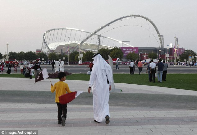 Auspicious beginnings: Fans travel to the  opening game between Qatar and Uzbekistan