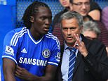 LONDON, ENGLAND - AUGUST 18:  Chelsea manager Jose Mourinho talks to substitute Romelu Lukaku of Chelsea during the Barclays Premier League match between Chelsea and Hull City at Stamford Bridge on August 18, 2013 in London, England.  (Photo by Richard Heathcote/Getty Images)