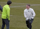 Germany's head coach Joachim Loew (L) oversees a training session of his players including Germany's midfielder Bastian Schweinsteiger (R) in Berlin on March 22, 2016. The German national team will play England in a friendly football match on March 26 at Berlin's Olympic Stadium. / AFP PHOTO / TOBIAS SCHWARZTOBIAS SCHWARZ/AFP/Getty Images