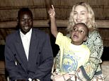 Madonna holds her adopted son David as they meet with the boy's biological father, Yohane Banda, left, at a lodge where the pop star is staying in Malawi, Monday March 30, 2009. (AP Photo/Tom Monroe) ** NO SALES ** In this photo made available by Madonna's publicist, Liz Rosenberg,
