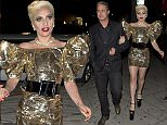 Lady Gaga and her fiancÈ Taylor Kinney were seen walking two full blocks to 'No Name ' Restaurant to celebrate Gaga's birthday party in Los Angeles, CA. A man was seen arriving with a piece of Artwork that gaga requested that was drawn by Michael Jackson and valued at $2 Million dollars. Gaga was wearing very large wedge heel shoes and a Gold Dress with wings on the shoulders while Taylor opted for a nice dress suit.\n\nPictured: Lady Gaga, Taylor Kinney\nRef: SPL1252756  270316  \nPicture by: SPW / TwisT / Splash News\n\nSplash News and Pictures\nLos Angeles: 310-821-2666\nNew York: 212-619-2666\nLondon: 870-934-2666\nphotodesk@splashnews.com\n
