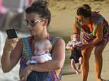 27 Mar 2016 - Bridgetown - Barbados *PREMIUM EXCLUSIVE - MUST CALL FOR PRICING - AVAILABLE FOR UK NEWSPAPERS ONLY* *** NO ONLINE SUBSCRIPTIONS ALLOWED *** Coleen Rooney brings out new baby Kit for a paddle on the beach in Barbados! BYLINE MUST READ : TANYA BOYCE-ISLANDPAPS/XPOSUREPHOTOS.COM ***UK CLIENTS - PICTURES CONTAINING CHILDREN PLEASE PIXELATE FACE PRIOR TO PUBLICATION *** **UK CLIENTS MUST CALL PRIOR TO TV OR ONLINE USAGE PLEASE TELEPHONE 44 208 344 2007**