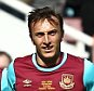 Mark Noble of West Ham United celebrates scoring the opening goal with team-mates   during the Mark Noble Testimonial  match between West Ham United and West Ham United All Stars    played at Boleyn Ground , London on 28th March 2015