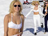26.MAR.2016 - Verbier - Switzerland ** PREMIUM EXCLUSIVE MUST CALL FOR PRICING ** ** STRICTLY NO WEB USAGE UNLESS FEE AGREED ** **AVALIABLE FOR UK NEWSPAPERS ONLY** *** AVAILABLE FOR UK SALE ONLY *** British pop singer Pixie Lott has fun in the snow in a bikini with friends and shares a drink with her boyfriend Oliver Cheshire during a ski vacation in Verbier, Switzerland BYLINE MUST READ : E-PRESS / XPOSUREPHOTOS.COM ***UK CLIENTS - PICTURES CONTAINING CHILDREN PLEASE PIXELATE FACE PRIOR TO PUBLICATION *** **UK CLIENTS MUST CALL PRIOR TO TV OR ONLINE USAGE PLEASE TELEPHONE 0208 344 2007**