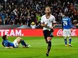 MUNICH, BAVARIA - MARCH 29:  Mario Goetze of Germany celebrates after scoring the second goal during the International Friendly match between Germany and Italy at Allianz Arena on March 29, 2016 in Munich, Germany.  (Photo by Dennis Grombkowski/Bongarts/Getty Images)