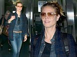 Heidi Klum arrives at LAX wearing Skinny Jeans and with her hair pulled back.\n\nPictured: Heidi Klum\nRef: SPL1253569  280316  \nPicture by: MONEY$HOT/Splash News\n\nSplash News and Pictures\nLos Angeles: 310-821-2666\nNew York: 212-619-2666\nLondon: 870-934-2666\nphotodesk@splashnews.com\n