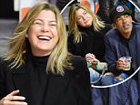 LOS ANGELES, CA - MARCH 28:  Ellen Pompeo (C) and Chris Ivery attend a basketball game between the Boston Celtics and the Los Angeles Clippers at Staples Center on March 28, 2016 in Los Angeles, California.  (Photo by Noel Vasquez/GC Images)