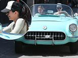 Beverly Hills,  CA - Kendall Jenner is seen driving her 56 Corvette out of the gym with friend Hailey Baldwin then going to grab some food at a grocery store. She also flips the bird to cameras, she's not too happy about being photographed.\n  \nAKM-GSI       March 26, 2016\nTo License These Photos, Please Contact :\nSteve Ginsburg\n(310) 505-8447\n(323) 423-9397\nsteve@akmgsi.com\nsales@akmgsi.com\nor\nMaria Buda\n(917) 242-1505\nmbuda@akmgsi.com\nginsburgspalyinc@gmail.com