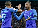 Netherlands' Luciano Narsingh, center, celebrates scoring his side's second goal during the international friendly soccer match between The Netherlands and England at Wembley stadium in London, Tuesday, March 29, 2016. (AP Photo/Frank Augstein)