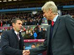 BIRMINGHAM, ENGLAND - DECEMBER 13:  Remi Garde of Aston Villa and Arsene Wenger manager of Arsenal shake hands prior to the Barclays Premier League match between Aston Villa and Arsenal at Villa Park on December 13, 2015 in Birmingham, England.  (Photo by Michael Regan/Getty Images)