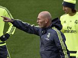 Real Madrid's new French coach Zinedine Zidane (C) points his finger next to Real Madrid's Welsh forward Gareth Bale (L) and Real Madrid's Croatian midfielder Luka Modric (R) during a training session at the Valdebebas training ground in Madrid on January 8, 2016.   AFP PHOTO / GERARD JULIEN / AFP / GERARD JULIEN        (Photo credit should read GERARD JULIEN/AFP/Getty Images)