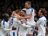 Leicester City's Riyad Mahrez (3rd R) celebrates after scoring his team's first goal during the English Premier League football match between Crystal Palace and Leicester City at Selhurst Park in south London on March 19, 2016. / AFP PHOTO / IKIMAGES / IKimages / RESTRICTED TO EDITORIAL USE. No use with unauthorized audio, video, data, fixture lists, club/league logos or 'live' services. Online in-match use limited to 45 images, no video emulation. No use in betting, games or single club/league/player publications.  / IKIMAGES/AFP/Getty Images