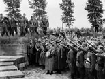 A picture taken in June 1940 during World War II shows Nazi Chancellor Adolf Hitler paying tribute to German soldiers fallen during the First World War