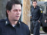 Exclusive... 52008494 Actor Mark Wahlberg is seen with two black eyes and a Boston Police Uniform on while filming scenes on the set of 'Patriots Day' in Boston, Massachusetts on March 30, 2016. 'Patriots Day' is the true story of the 2013 Boston Marathon bombing. FameFlynet, Inc - Beverly Hills, CA, USA - +1 (310) 505-9876