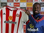 SUNDERLAND, UNITED KINGDOM - MARCH 09:  New Sunderland signing Emmanuel Eboue is pictured with a club shirt at the Academy of Light on March 09, 2016 in Sunderland, England. (Photo by Ian Horrocks/Sunderland AFC via Getty Images)