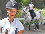 Picture Shows: Iggy Azalea  March 30, 2016\n \n Singer Iggy Azalea goes horseback riding in Los Angeles. Iggy recently released her new single 'Team'.\n \n Non-Exclusive\n UK RIGHTS ONLY\n \n Pictures by : FameFlynet UK © 2016\n Tel : +44 (0)20 3551 5049\n Email : info@fameflynet.uk.com