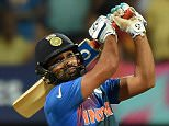 India's Rohit Sharma plays a shot during the World T20 cricket tournament semi-final match between India and West Indies at The Wankhede Cricket Stadium in Mumbai on March 31, 2016. / AFP PHOTO / PUNIT PARANJPEPUNIT PARANJPE/AFP/Getty Images