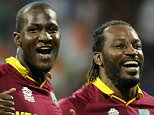 Mumbaj, INDIA - MARCH 31 : Dwayne Bravo of the West Indies (L) Darren Sammy, Captain of the West Indies (C) and Chris Gayle of the West Indies celebrate after winning the ICC World Twenty20 India 2016 Semi Final match between India and West Indies on March 31, 2016 in Mumbai, India. (Photo by Pal Pillai/IDI via Getty Images)