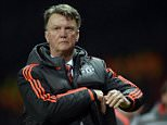 Manchester United's Dutch manager Louis van Gaal reacts as he leaves the pitch after the UEFA Europa League round of 16, second leg football match between Manchester United and Liverpool at Old Trafford in Manchester, north west England on March 17, 2016. The game ended 1-1, Liverpool going through 3-1 on aggregate. / AFP PHOTO / OLI SCARFFOLI SCARFF/AFP/Getty Images