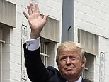 Republican presidential candidate Donald Trump waves as he gets into his vehicle in Washington, Thursday, March 31, 2016, following a meeting at the Republican National Committee. (AP Photo/Susan Walsh)