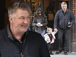 New York, NY - Alec Baldwin and Hilaria Baldwin take their two year old Carmen on a walk in the West Village. The parents are expecting their third child. Hilaria took to Instagram to give the news of the pregnancy. The two parents stop in a shop for a coffee to go. Hilaria is all bundled up wearing a puffer jacket over a sweater, yet she is wearing flip flops! \nAKM-GSI        March 30, 2016\nTo License These Photos, Please Contact :\nSteve Ginsburg\n(310) 505-8447\n(323) 423-9397\nsteve@akmgsi.com\nsales@akmgsi.com\nor\nMaria Buda\n(917) 242-1505\nmbuda@akmgsi.com\nginsburgspalyinc@gmail.com