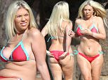 EXCLUSIVE ALL ROUND PICTURE: TREVOR ADAMS / MATRIXPICTURES.CO.UK PLEASE CREDIT ALL USES WORLD RIGHTS ***DOUBLE SPACE RATES APPLY*** Frankie Essex is spotted during a relaxing day out while on holiday in Cyprus. The former TOWIE star, who has put on a whopping 3 stone since leaving the show, displays her curves in a red and aqua bikini. MARCH 21st 2016 REF: UPR 16770