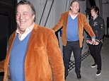 British actor and comedian Stephen Fry and his husband Elliot Spencer were seen arriving for dinner at 'Craigs' Restaurant in West Hollywood, CA  Pictured: Steven Fry, Elliot Spencer Ref: SPL1254737  300316   Picture by: SPW / Splash News  Splash News and Pictures Los Angeles: 310-821-2666 New York: 212-619-2666 London: 870-934-2666 photodesk@splashnews.com