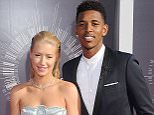 INGLEWOOD, CA - AUGUST 24: Singer Iggy Azalea and Nick Young arrive at the 2014 MTV Video Music Awards at The Forum on August 24, 2014 in Inglewood, California.  (Photo by Gregg DeGuire/WireImage)