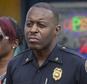 """In this Jan. 2, 2016, photo, Miami Police Maj. Delrish Moss stands among the Miami-Dade officials who announced the arrest of Willie """"Pee Wee"""" Wilcher in Liberty City, Fla. Moss was announced as police chief in Ferguson, Mo., Thursday, March 31, 2016, putting a black man in charge of a mostly white department that serves a town where African-Americans make up two-thirds of the residents. (Matias J. Ocner/The Miami Herald via AP) MAGS OUT; MANDATORY CREDIT"""
