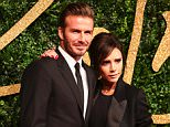 British footballer David Beckham (L) and his wife British designer Victoria Beckham (R) pose for pictures on the red carpet upon arrival to attend the British Fashion Awards 2015 in London on November 23, 2015. AFP PHOTO / JACK TAYLOR / AFP / JACK TAYLOR        (Photo credit should read JACK TAYLOR/AFP/Getty Images)