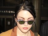 Frances Bean Cobain seen for the first time since news broke she's reportedly getting a divorce in an attempt to protect her later father's $450 million fortune.  The daughter of former Nirvana singer, Kurt Cobain was seen arriving into LAX with a fashion statement ring on her left hand.  Pictured: Frances Bean Cobain Ref: SPL1252552  250316   Picture by: Sharky / Splash News  Splash News and Pictures Los Angeles: 310-821-2666 New York: 212-619-2666 London: 870-934-2666 photodesk@splashnews.com