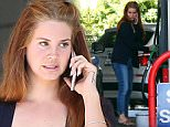 Picture Shows: Lana Del Rey  April 01, 2016\n \n 'Ultraviolence' singer Lana Del Rey was seen stopping to pump some gas at a gas station in Beverly Hills, California. Lana recently released 'Honeymoon' her fourth studio album, to critical acclaim. \n \n Non-Exclusive\n UK RIGHTS ONLY\n \n Pictures by : FameFlynet UK © 2016\n Tel : +44 (0)20 3551 5049\n Email : info@fameflynet.uk.com