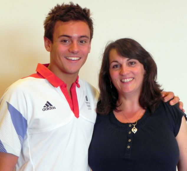 That's my boy: Proud mother Debbie and Team GB hero Tom smile for the camera