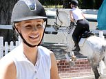 Iggy Azalea rides her horse at an equestrian center outside of Los Angeles on Friday.\n\nPictured: Iggy Azalea rides her horse at equestrian center\nRef: SPL1255434  010416  \nPicture by: INTERSTAR/Splash News\n\nSplash News and Pictures\nLos Angeles: 310-821-2666\nNew York: 212-619-2666\nLondon: 870-934-2666\nphotodesk@splashnews.com\n