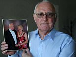 John Nicholas, whose wife, Diane died on a cruise off the Australian coast last year. Mr Nicholas is pictured, with a photo of them taken just two months before her death, at their home in Malvern.