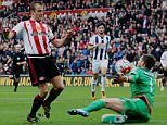 SUNDERLAND, UNITED KINGDOM - APRIL 02: Lee Cattermole of  Sunderland (L) has his shot saved by West Bromwich keeper Ben Foster during the Barclays Premier League match between Sunderland and West Bromwich Albion at the Stadium of Light on April 02, 2016 in Sunderland, England. (Photo by Ian Horrocks/Sunderland AFC via Getty Images)