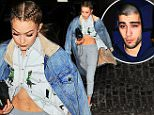 Gigi Hadid bares her toned tummy and rocking boxer braids as she arrives at her apartment with Zayn Malik in NYC. Zayn rented out an entire movie theater to watch Batman vs. Superman. Gigi waited 20 minutes in the lobby for Zayn to return. She popped up at him scaring him when he entered. Gigi wore a long denim coat with a unbuttoned dinosaur shirt  Pictured: Gigi Hadid and Zayn Malik Ref: SPL1255347  310316   Picture by: Splash News  Splash News and Pictures Los Angeles: 310-821-2666 New York: 212-619-2666 London: 870-934-2666 photodesk@splashnews.com