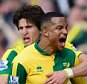 NORWICH, ENGLAND - APRIL 02:  Martin Olsson (1st R) of Norwich City celebrates scoring his team's third goal with his team mates during the Barclays Premier League match between Norwich City and Newcastle United at Carrow Road on April 2, 2016 in Norwich, England.  (Photo by Dan Mullan/Getty Images)