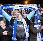 LONDON, ENGLAND - MARCH 19:  Leicester City fans celebrate going 8 points clear at the top of the Premier League after the Premier League match between Crystal Palace and Leicester City at Selhurst Park on March 19, 2016 in London, United Kingdom.  (Photo by Plumb Images/Leicester City FC via Getty Images)