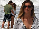 03/27/2016\nPREMIUM EXCLUSIVE Tom and Gisele wrap up their vacation in Costa Rica with a kiss on the beach! After spending the day with family the couple returned to the beach for a moment of quality time together. The couple seemed to be enjoying their time together in the very picturesque setting.\nPlease byline:TheImageDirect.com\n*EXCLUSIVE PLEASE EMAIL sales@theimagedirect.com FOR FEES BEFORE USE